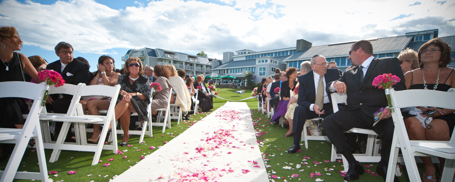 Aisle with pink petals outside during ceremony. Photo courtesy of Focus Photography