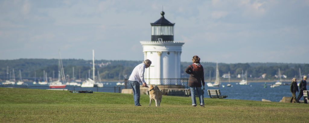 Lighthouse with Couple and Dog