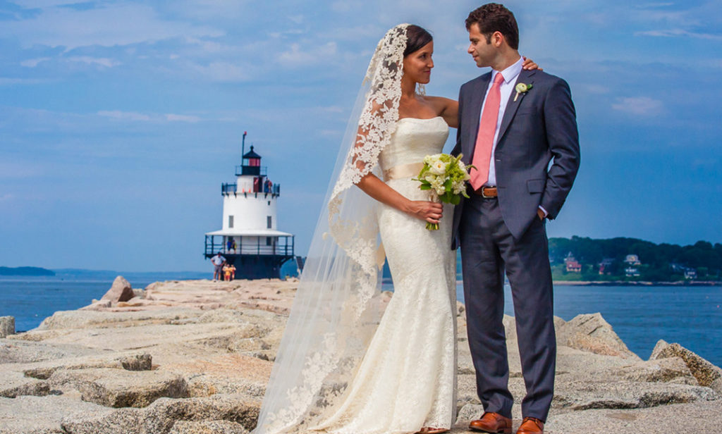 Bride and Groom Posing in Front of Lighthouse, Photo Credit: Luxury Hero