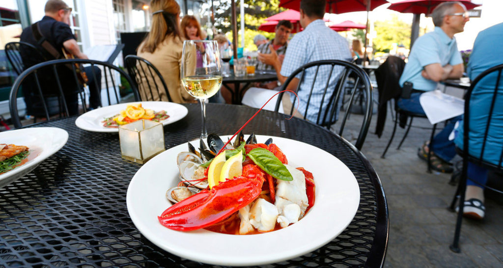 Photo Credit: Visit Freeport,Enjoy a lobster dinner while being outside in the fresh Maine air during hot summer months.