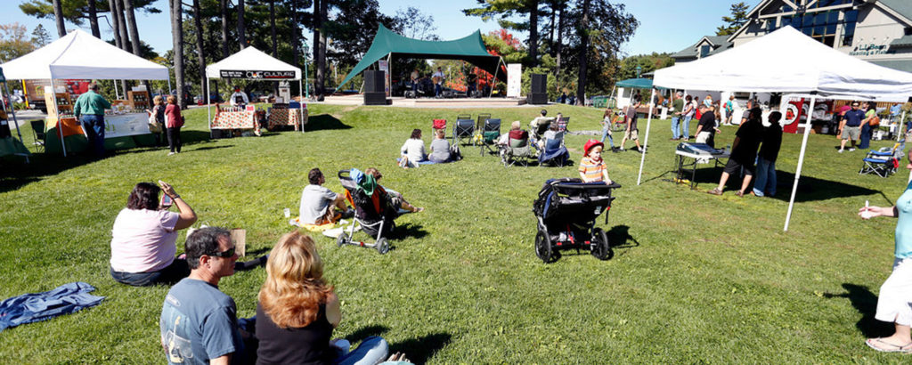Crowds relaxing on lawn at Freeport Fall Festival, Image provided by Visit Freeport