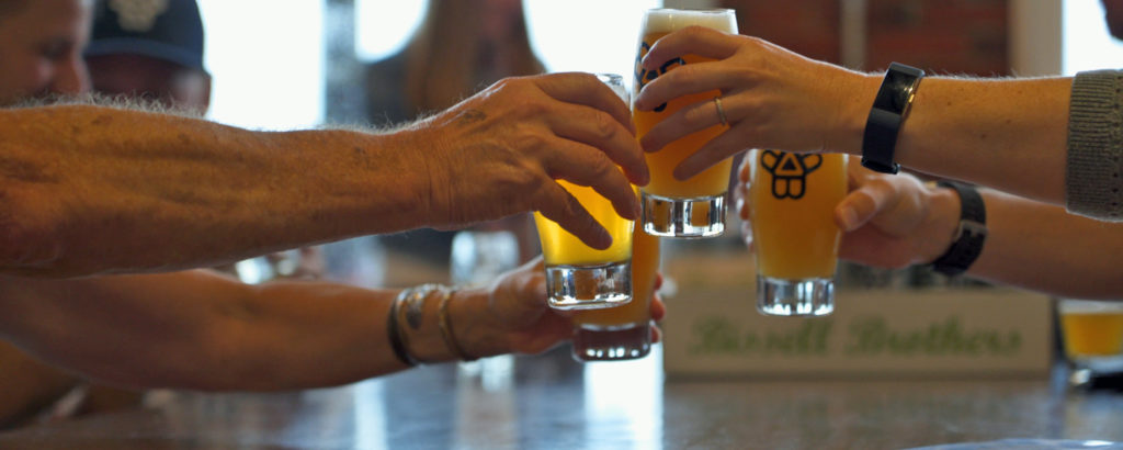 Group Cheers at Brewery, Photo Courtesy of GLP FIlms