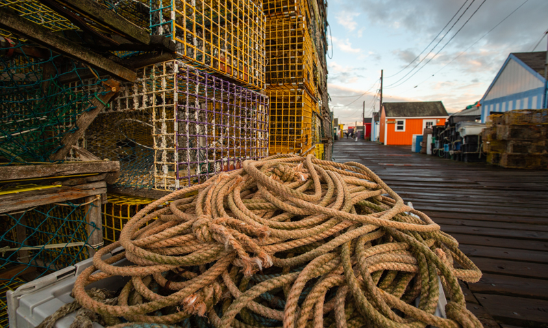 Lobster Crates and Pile of Rope on Working Waterfront, Photo Credit: Visit USA Parks and Tobey Schmidt