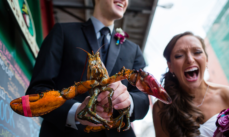 Couple Kissing Holding Lobster, Photo Credit: Emilie Inc.