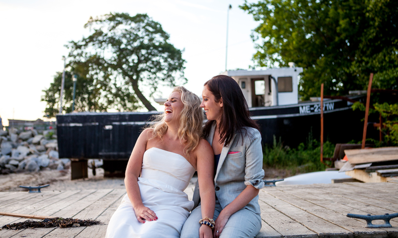 Couple at Wedding Outside Behind Boat, Photo Credit: Emilie Inc.
