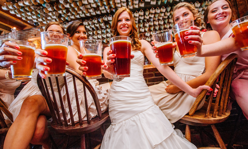 Group of Women Holding Beers, Photo Credit: Bethany and Dan Photography