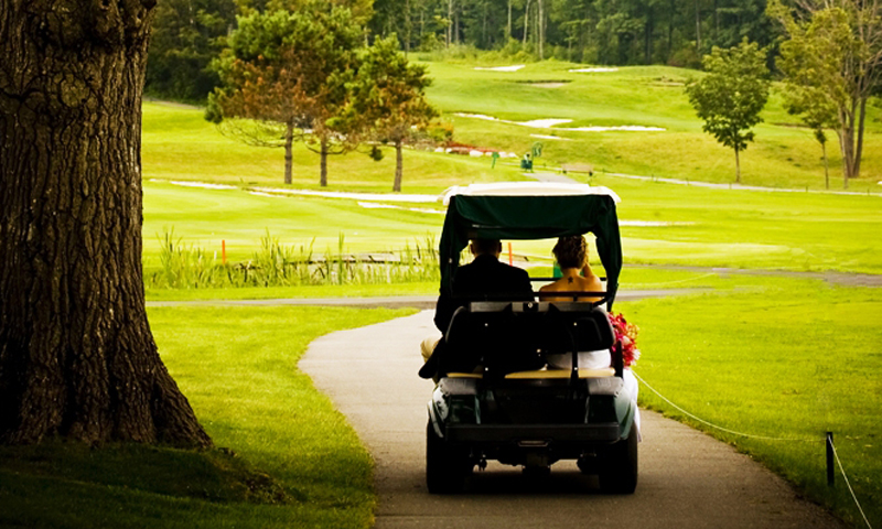 Couple in Golf Cart, Photo Credit: Focus Photography