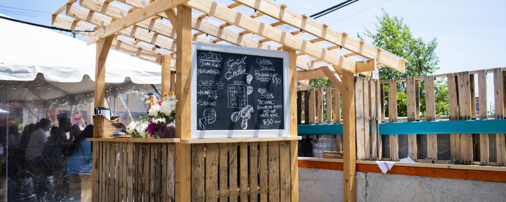Outdoor Seating at East Ender. Photo Credit: Capshore Photography
