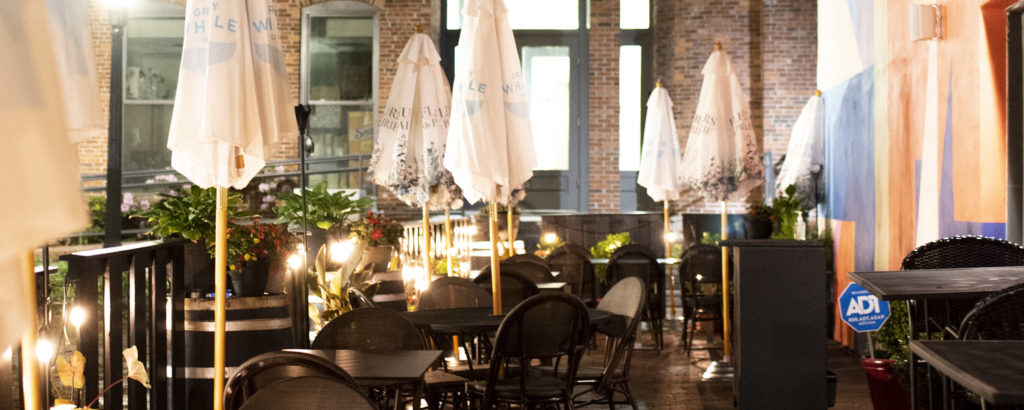 Outside seating in Portland at night. Photo Credit: Capshore Photography
