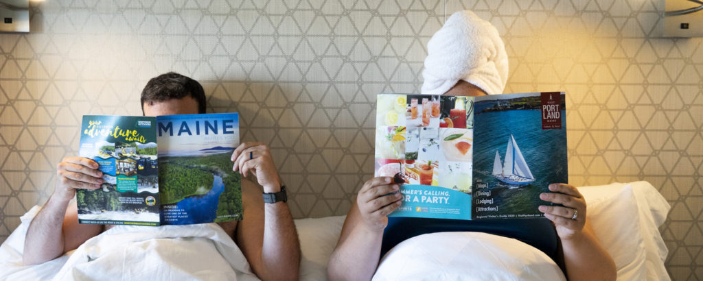 Amy + Dan at Hotel with Magazines, Photo Credit: Capshore Photography